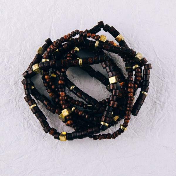 """Wood beaded boho stretch bracelet set of eight featuring gold bead accents. Approximately 3"""" in diameter unstretched. Fits up to a 6"""" wrist."""