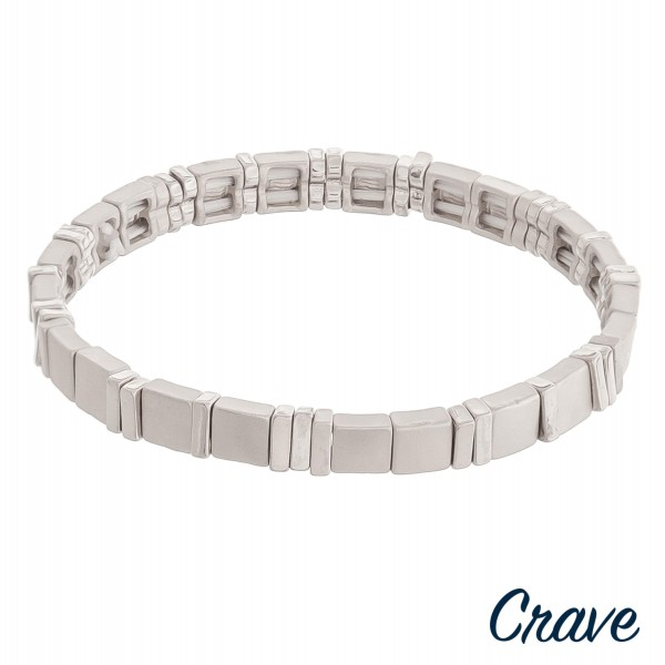 """Metal tone metal stretch bracelet.  - Approximately 3"""" in diameter unstretched - Fits up to a 6"""" wrist"""