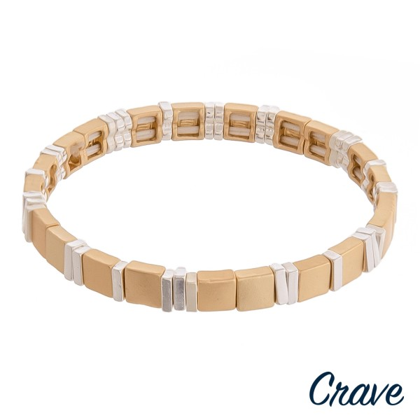 """Two tone metal stretch bracelet.  - Approximately 3"""" in diameter unstretched - Fits up to a 6"""" wrist"""