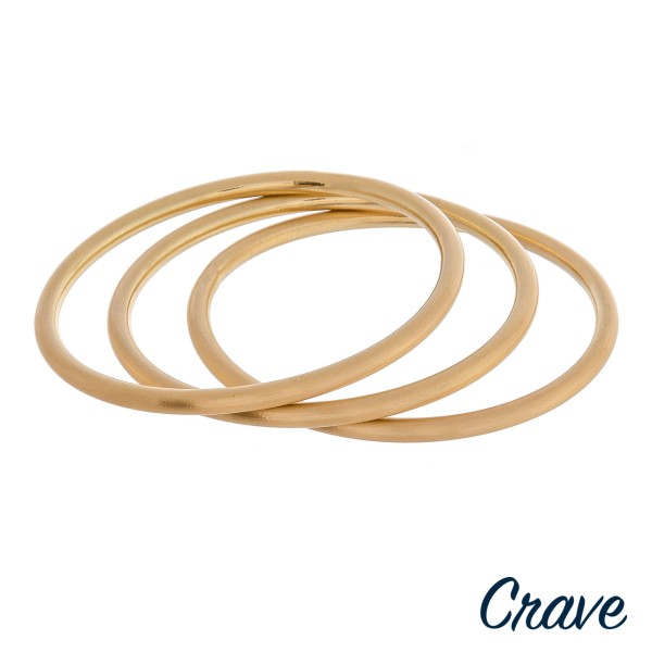 """Matte metal bangle bracelet set of three.  - Approximately 3"""" in diameter - Fits up to a 6"""" wrist"""
