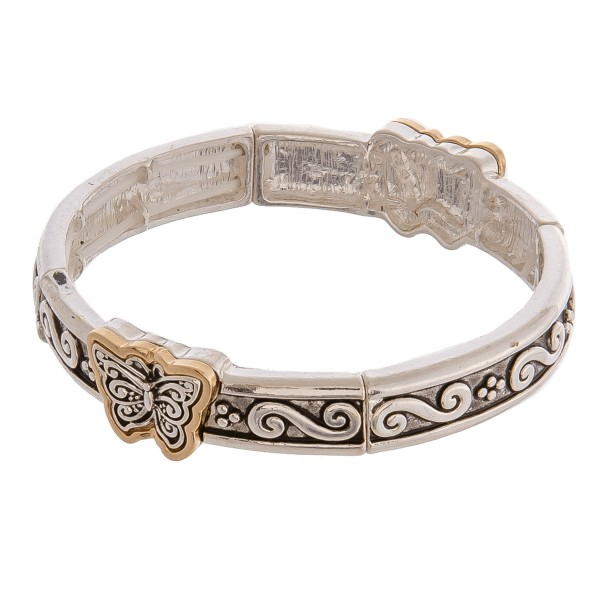 """Two tone antique silver metal butterfly filigree stretch bracelet. Approximately 3"""" in diameter unstretched. Fits up to a 6"""" wrist."""