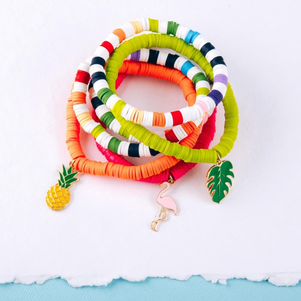 """Spacer beaded stretch bracelet set of two with an enamel coated pineapple charm.  - Approximately 3"""" in diameter unstretched - Fits up to a 6"""" wrist"""