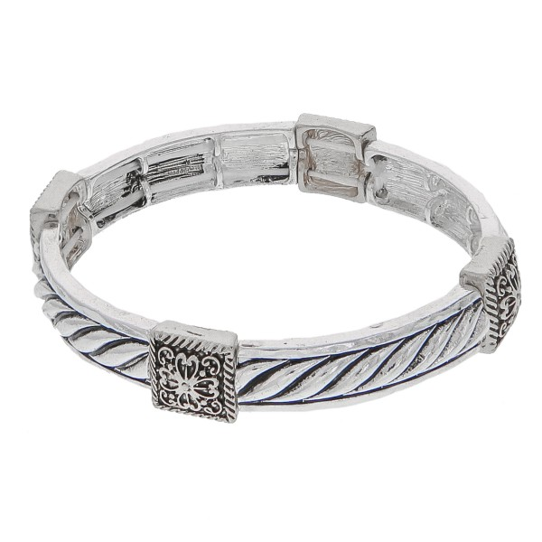 """Antique silver metal stretch bracelet.   - Approximately 3"""" in diameter unstretched  - Fits up to a 6"""" wrist"""