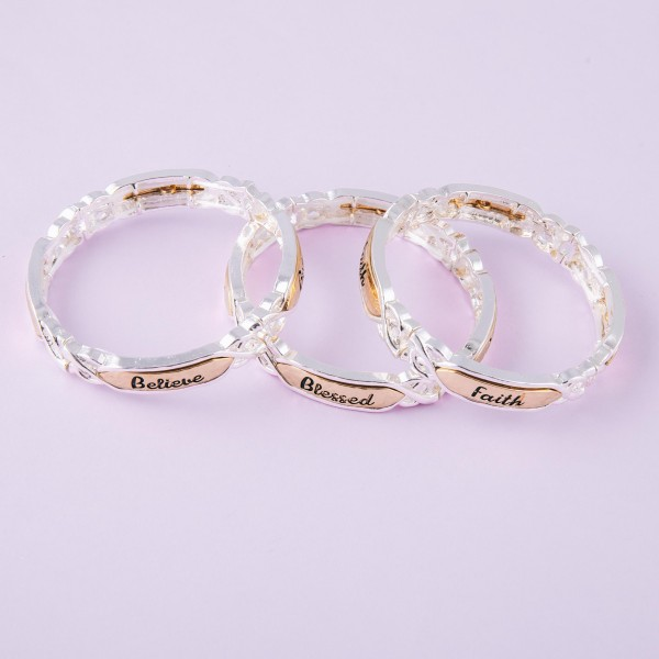 """Believe engraved two tone gold and silver metal stretch bracelet.  - Approximately 3"""" in diameter unstretched - Fits up to a 6"""" wrist unstretched - Fits up to a 6"""" wrist"""