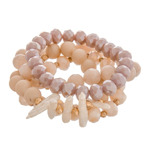 """Semi precious beaded stretch bracelet set of four with freshwater pearl details. Approximately 3"""" in diameter unstretched. Fits up to a 6"""" wrist."""