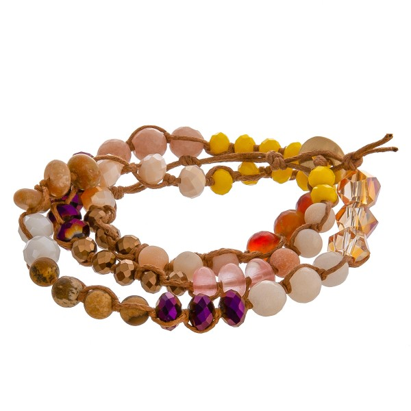 """Multicolor semi precious beaded wrap cord bracelet. Approximately 3"""" in diameter. Fits up to a 6"""" wrist."""