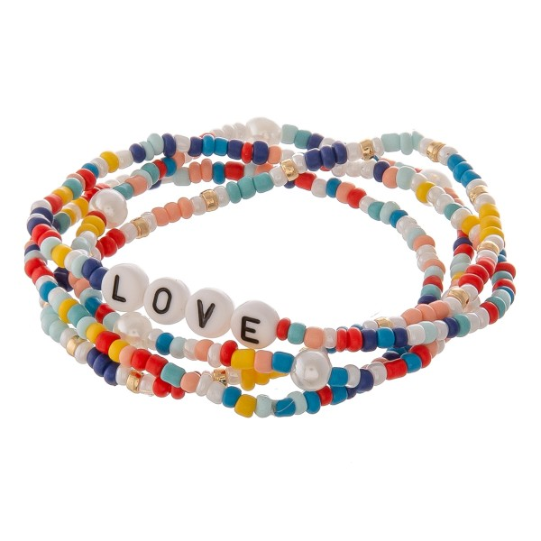 """Multicolor seed beaded """"Love"""" letter stretch bracelet set with pearl details.  - 4pcs/pack - Approximately 3"""" in diameter unstretched - Fits up to a 7"""" wrist"""