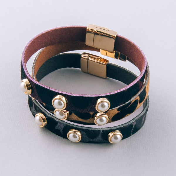 """Cowhide leopard print pearl stud magnetic bracelet.  - Magnetic closure - Approximately 3"""" in diameter  - Fits up to a 6"""" wrist"""