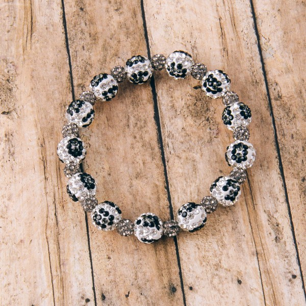 """Black and white rhinestone leopard print stretch bracelet.  - Approximately 3"""" in diameter unstretched - Fits up to a 6"""" wrist"""