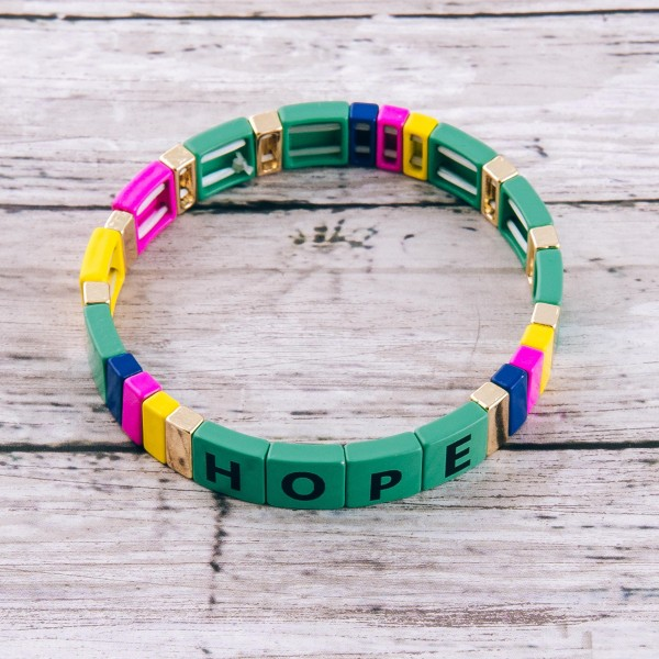 """Inspirational shiny enamel coated """"Hope"""" letter color block stretch bracelet.  - Approximately 3"""" in diameter unstretched - Fits up to a 7"""" wrist"""