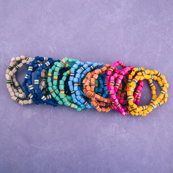 """Shiny enamel coated block beaded stretch bracelet set with spacer bead details.  - 3 pcs/pack - Approximately 3"""" in diameter unstretched - Fits up to a 7"""" wrist"""