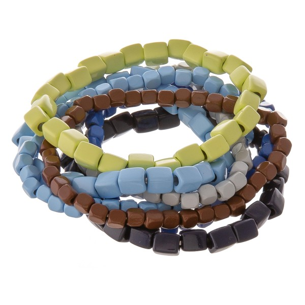 """Shiny enamel coated multi color block beaded stretch bracelet set.  - 7 pcs/pack - Approximately 3"""" in diameter unstretched. - Fits up to a 7"""" wrist"""
