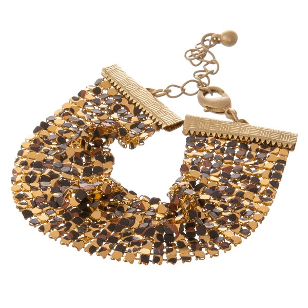 """Leopard print metal mesh bracelet with adjustable lobster clasp closure.  - Approximately 3"""" in diameter - Fits up to a 6"""" wrist  - 2"""" adjustable clasp - Approximately 1"""" in width"""