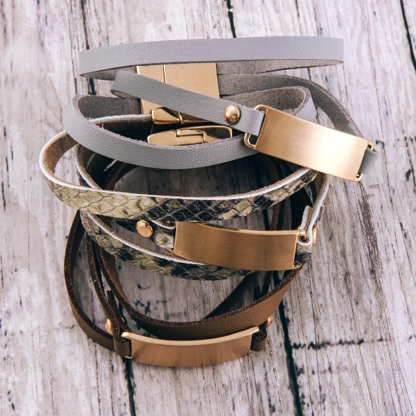 """Faux leather multi strand magnetic bracelet with a gold metal focal detail.  - Magnetic closure - Approximately 3"""" in diameter - Fits up to a 6"""" wrist"""