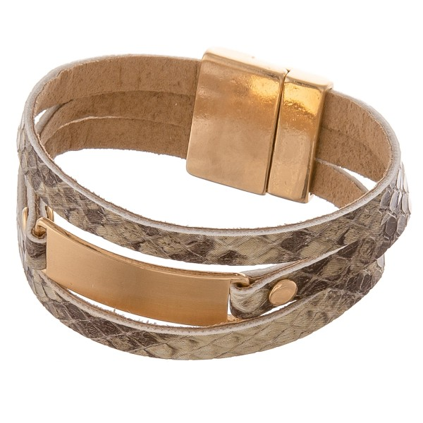 """Faux leather multi strand snakeskin magnetic bracelet with a gold metal focal detail.  - Magnetic closure - Approximately 3"""" in diameter - Fits up to a 6"""" wrist"""