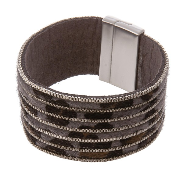"""Leopard print cowhide metal striped magnetic bracelet.  - Faux leather - Magnetic closure - Approximately 3"""" in diameter - Fits up to a 6"""" wrist"""