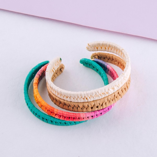 "Raffia woven cuff bracelet.  - Approximately 2.5"" in diameter - Fits up to a 5"" wrist"