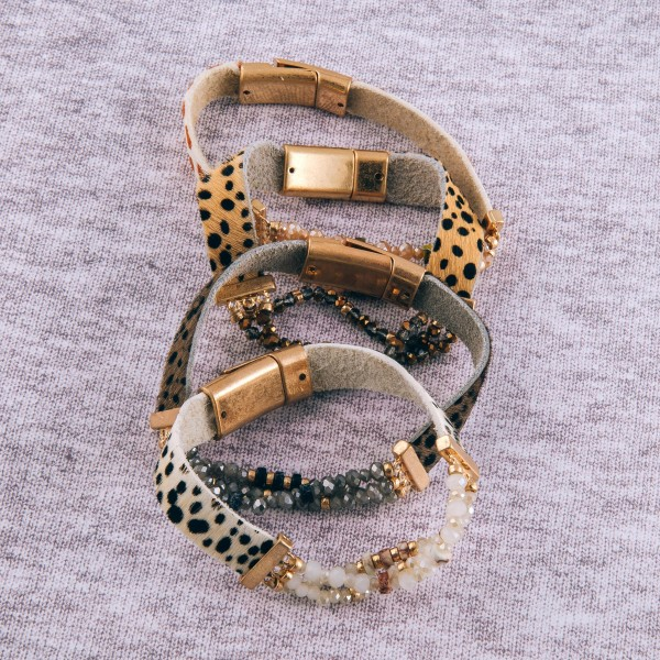 """Genuine leather cow print beaded stretch magnetic bracelet with natural stone details.  - Magnetic closure  - Approximately 3"""" in diameter - Fits up to a 6"""" wrist"""