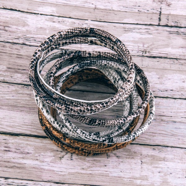 """Faux leather wrapped snakeskin bangle bracelet set of three.  - Approximately 3"""" in diameter - Fits up to a 6"""" wrist"""