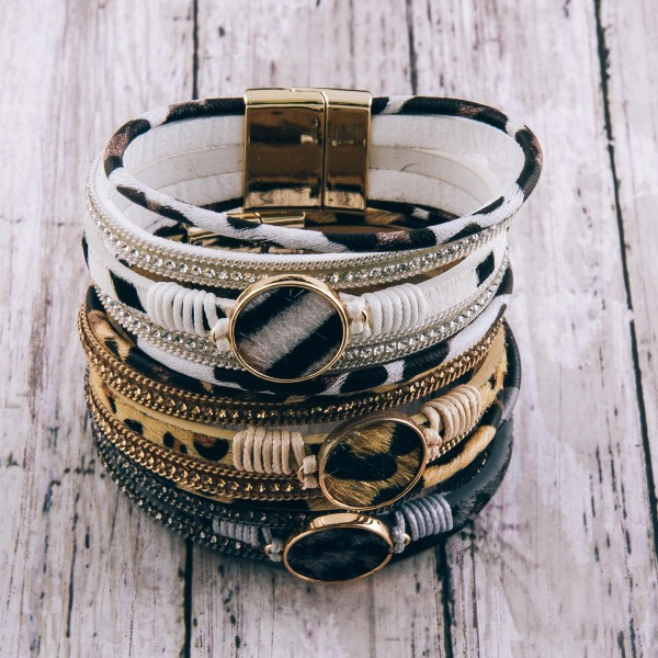 """Faux leather wrapped multi strand leopard print magnetic bracelet with cowhide focal, rhinestones and thread wrapped details.  - Magnetic closure - Approximately 3"""" in diameter - Fits up to a 6"""" wrist"""