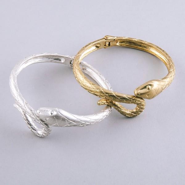 "Designer inspired metal snake hinge bangle bracelet.  - Approximately 3"" in diameter - Fits up to a 6"" wrist"