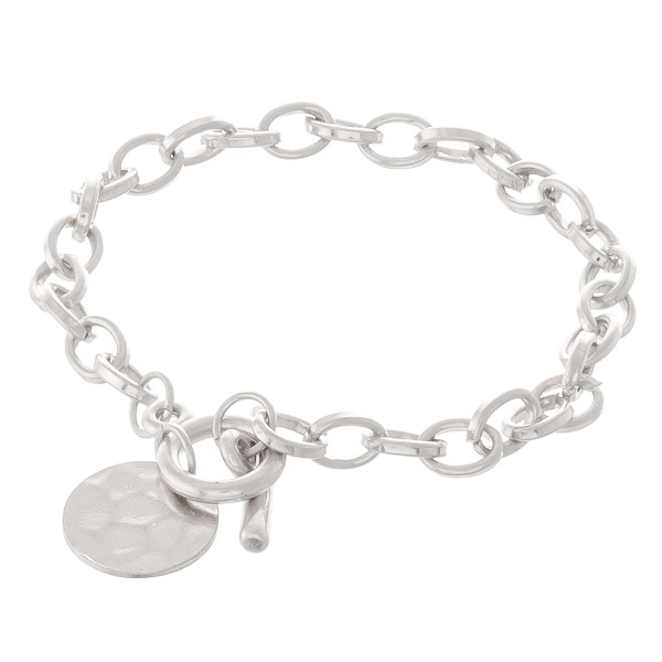 """Hammered disc toggle bracelet.  - Toggle bar clasp  - Approximately 3"""" in diameter - Fits up to a 6"""" wrist"""