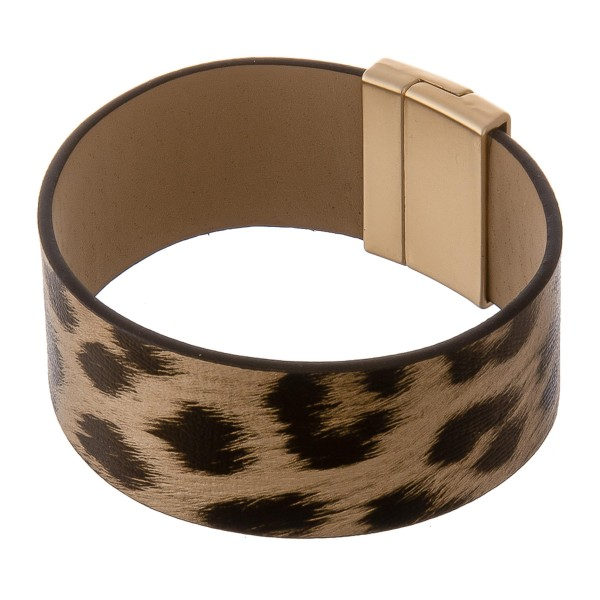 """Faux leather leopard print magnetic bracelet.  - Magnetic closure - Approximately 3"""" in diameter - Fits up to a 6"""" wrist - Approximately 1"""" wide"""