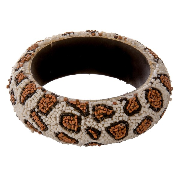 """Seed beaded leopard print statement bangle bracelet.  - Approximately 3"""" in diameter - Fits up to a 6"""" wrist"""