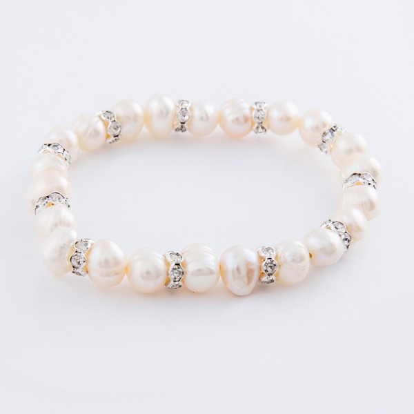 "Freshwater pearl beaded stretch bracelet with rhinestone spacer accents.  - Approximately 3"" in diameter unstretched - Fits up to a 7"" wrist"