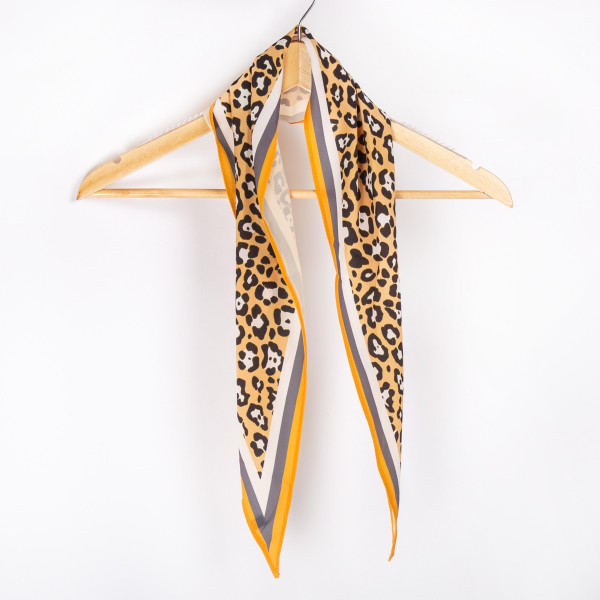 "Leopard with yellow  border neckerchief. 100% polyester. Approximate 28x28"" in length."