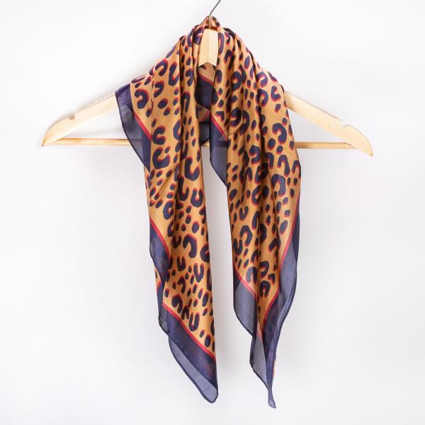 "Leopard neckerchief. 100% polyester. Approximate 28x28"" in length."