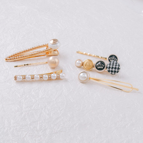 "Trio set of hair pins featuring pearl beaded details and rhinestone accents. Approximately 3"" in length."