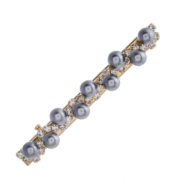 "Gold hair clip featuring pearl beaded details and rhinestone accents. Approximately 2.5"" in length."