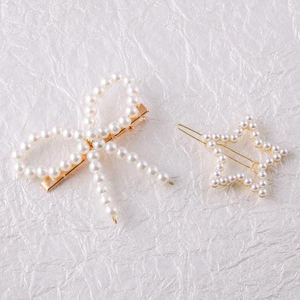 "Star hair barrette featuring pearl beaded details. Approximately 2"" in length."