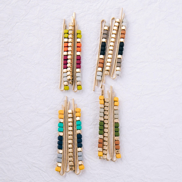 """Hair pin set featuring three hair pins with color-block beaded details. Approximately 3"""" in length."""