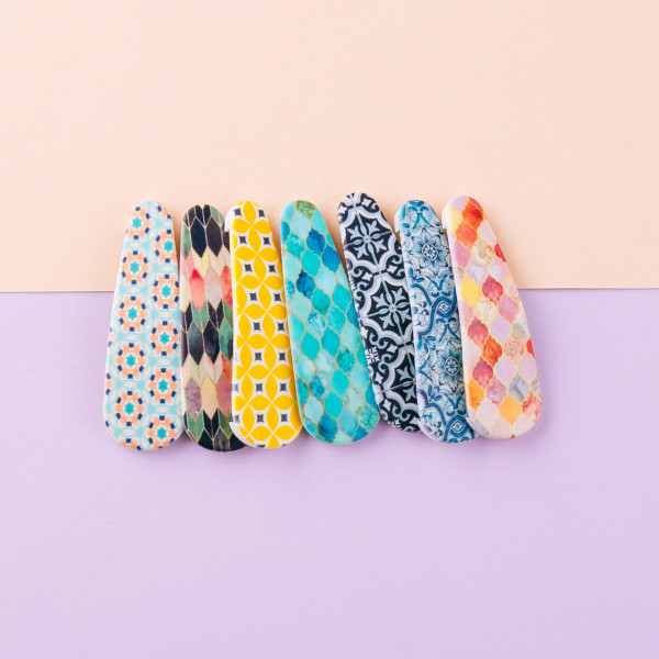 """Flexible matte plastic hair clip featuring a multicolor pattern detail. Pack includes two clips. Approximately 2"""" in length."""