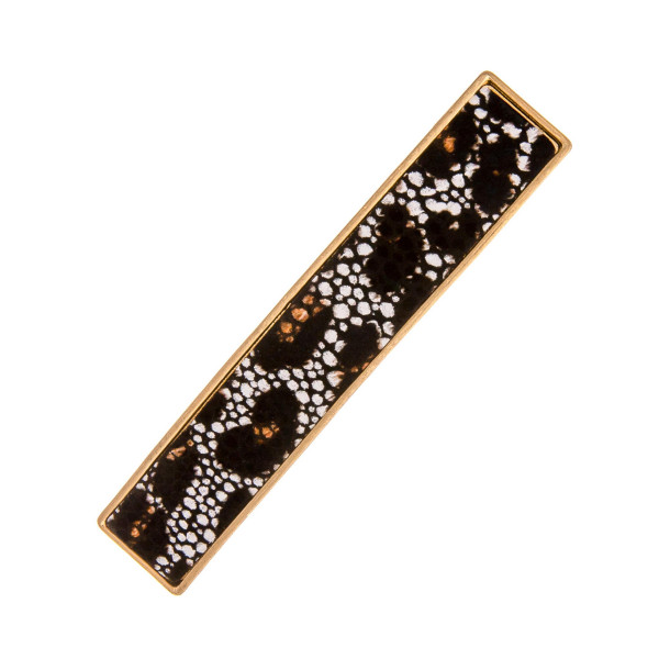 "Faux leather hair barrette with leopard print details. Approximately 3"" in length."
