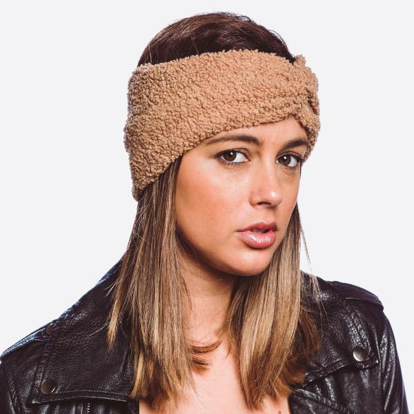 Solid sherpa fleece headband.   - One size fits most  - 100% Acrylic