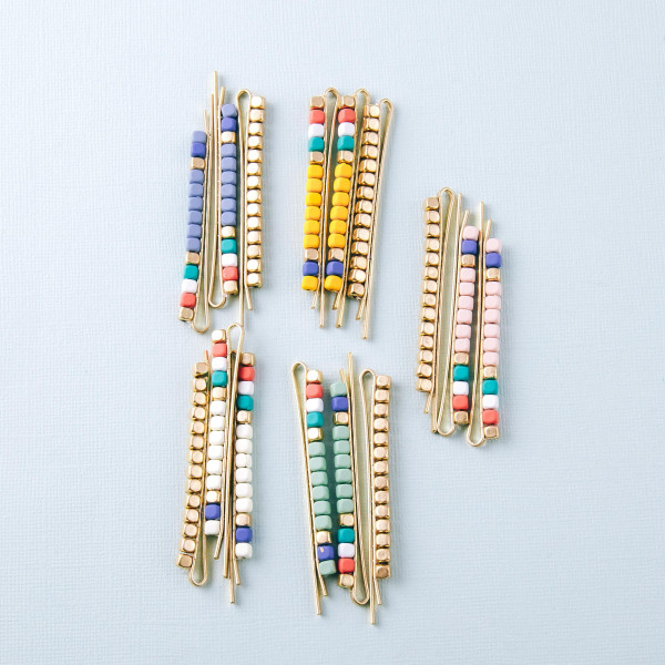 "Hair pin set featuring three hair pins with color-block beaded details. Approximately 3"" in length."
