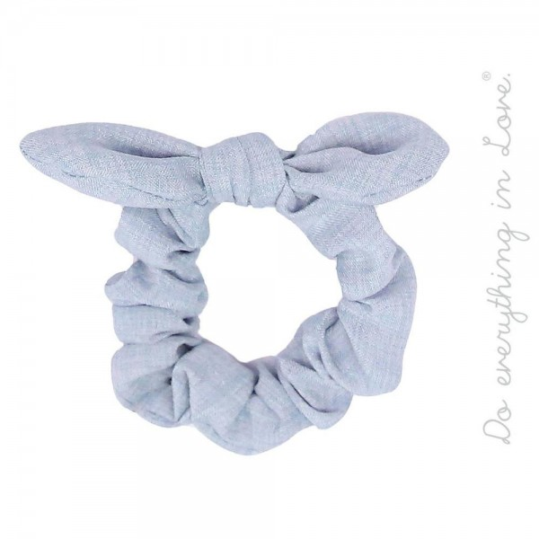 Do everything in Love brand solid color knotted bow tie hair scrunchie.  - One size fits most  - 100% Polyester
