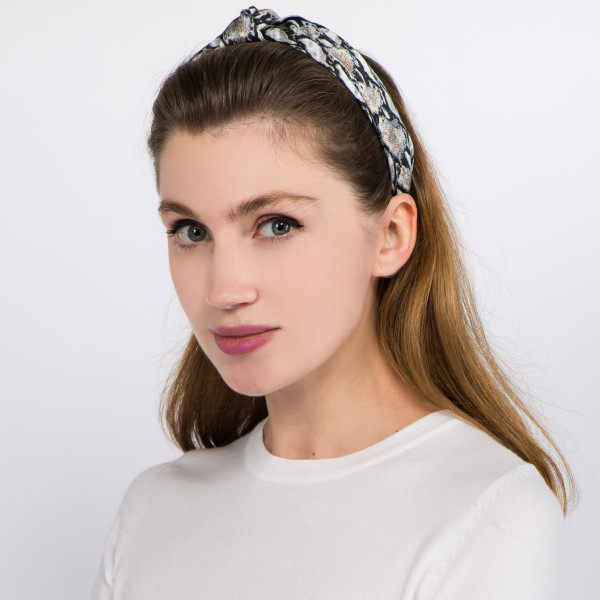 Knotted snakeskin headband.  - One size fits most - 100% Polyester