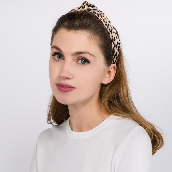 Knotted leopard print headband.  - One size fits most - 100% Polyester