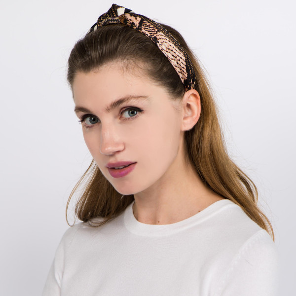 Knotted multi animal print headband.  - One size fits most - 100% Polyester
