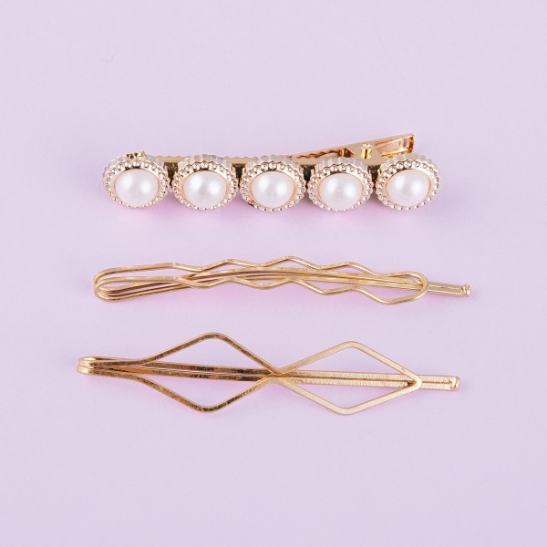 "Hair pin set featuring:  - 1 pearl bead hair clip - 2 geometric hair pins  Approximately 2.5"" in length."