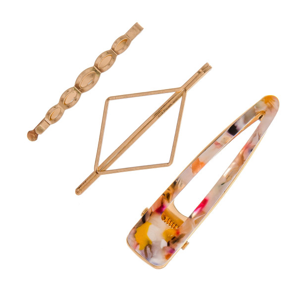 """Hair pin set featuring:  - 1 resin marble hair clip - 1 diamond shape pin - 1 geometric pin  Approximately 2.5"""" in length."""