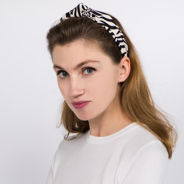 Black and white animal print knotted headband.  - One size fits most - 100% Polyester