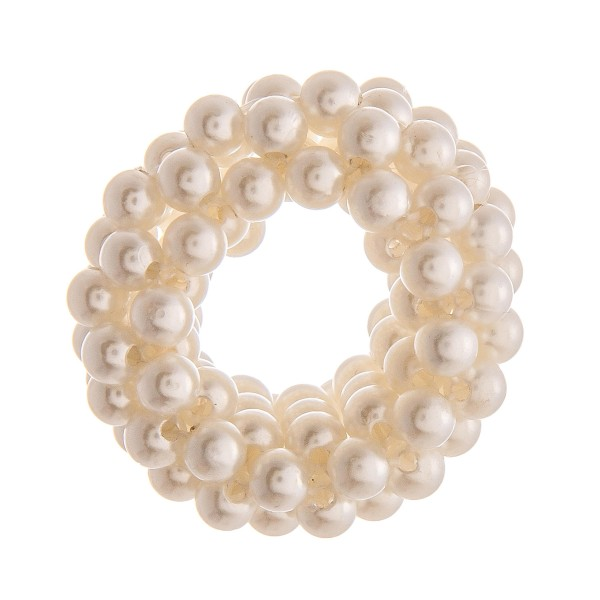 "Medium size pearl beaded stretch rope scrunchie ponytail hair accessory. Approximately 1"" in diameter."