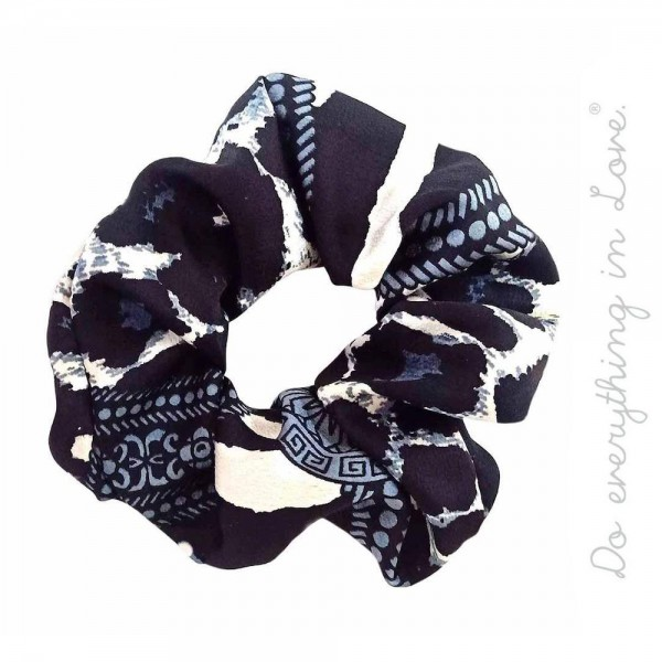 Do everything in Love brand designer leopard print scrunchie.  - One size - 100% Polyester
