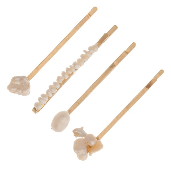 "Faux pearl hair pin set of four.  - Pearls vary in size - Approximately 1.5"" in length"