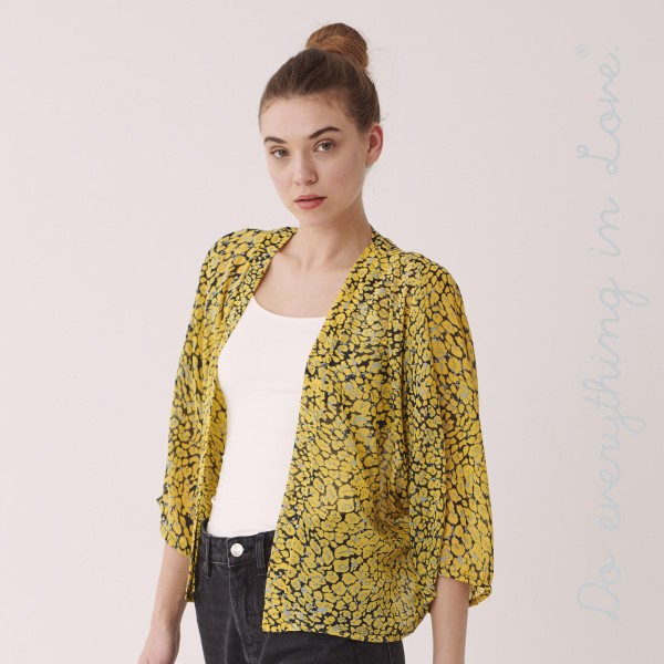 """Do everything in Love brand women's lightweight leopard print crop kimono.  - One size fits most 0-14 - Approximately 28"""" L - 100% Polyester"""
